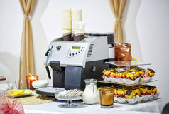 Coffee maker and desserts with biscuits, decorated Banquet table. Beautifully decorated Banquet table. desserts with biscuits with coffee maker Stock Photo