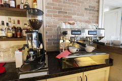 Coffee maker and espresso machine at restaurant counter Stock Photos