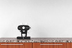 Coffee maker in front of white wall Stock Photography