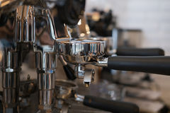 Coffee maker machine brewing fresh espresso coffee in cafe Stock Image