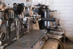 Coffee maker machine brewing fresh espresso coffee in cafe Stock Photos