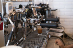 Coffee maker machine brewing and pouring fresh espresso coffee i Stock Images