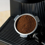 Coffee maker machine with ground coffee. Close up coffee maker machine with ground coffee Stock Photos