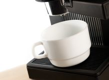 Coffee maker machine with white coffee cup Royalty Free Stock Photos