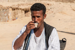 Coffee Maker. Marsa Alam, Red Sea/ Egypt – OCTOBER 31: unidentified Bedouin young man from Bishari Tribe drinks fresh Bedouin coffee called gabana in Royalty Free Stock Photography