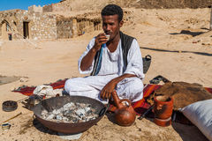 Coffee Maker. Marsa Alam, Red Sea/ Egypt – OCTOBER 31: unidentified Bedouin young man from Bishari Tribe drinks fresh Bedouin coffee called gabana in Stock Images
