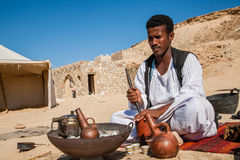 Coffee Maker. Marsa Alam, Red Sea/ Egypt – OCTOBER 31: unidentified Bedouin young man from Bishari Tribe grind coffee beans using a grinder made from clay, to Stock Images