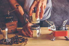 Coffee maker. Method of Moka pot coffee maker ,fill coffee ground to filter and close a pot before boiling Royalty Free Stock Photos