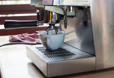 Coffee maker. A photo of a coffee maker machine is making a cup of espresso Royalty Free Stock Image