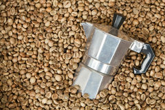 Coffee maker pot with Coffee beans Stock Photo