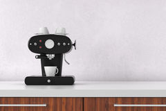 Coffee maker with white wall Royalty Free Stock Images