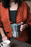 Coffee maker. Woman holding old italian coffee maker Royalty Free Stock Photos