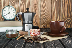 Coffee maker on wood desk. Coffee maker with cup on wood desk. Food background Royalty Free Stock Image
