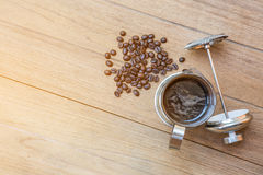 Coffee maker on wood table Stock Image