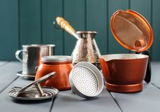Coffee makers: Italian moka pot, Turkish cezve, Vietnamese phin. On gray background horizontal Stock Images