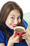 Coffee makes me cheerful. Pretty Asian Hispanic Women enjoying her morning cup of coffee with a big smile on her face Royalty Free Stock Photos