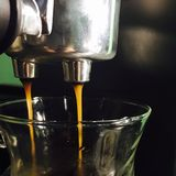 Coffee making. Making espresso with coffee machine Royalty Free Stock Photo