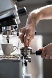 Coffee making process; espresso cup and coffee machine;. Bartender make morning espresso; coffee brewing Royalty Free Stock Images
