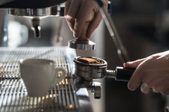 Coffee making process; espresso cup and coffee machine; Stock Image
