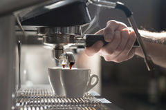 Coffee making process; espresso cup and coffee machine; Stock Photo