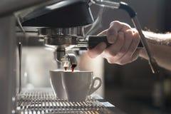 Coffee making process; espresso cup and coffee machine;. Bartender make morning espresso; coffee brewing Stock Photo