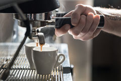 Coffee making process; espresso cup and coffee machine;. Bartender make morning espresso; coffee brewing Stock Photos