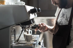 Coffee making process; espresso cup and coffee machine;. Bartender make morning espresso; coffee brewing Stock Photography
