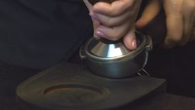 Tamp down for get balance cup. Coffee making process espresso cup and coffee machine bartender make morning espresso,Tamp down for get balance cup.man using a stock video footage
