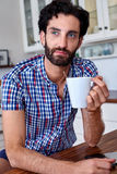Coffee man kitchen Stock Images