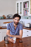 Coffee man kitchen portrait Stock Image