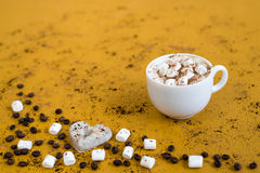 Coffee with marsh-mallows on yellow background. Cup of coffee with marsh-mallows on yellow background Royalty Free Stock Photo