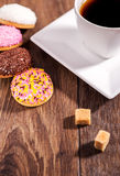 Coffee and marshmallow biscuits with icing colored granules on w Stock Images