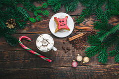 Coffee with marshmallow and cake on christmas decoration. Top view Stock Photos