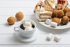 Coffee with marshmallow on white wooden background Stock Photo