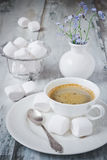 Coffee and marshmallows Stock Images
