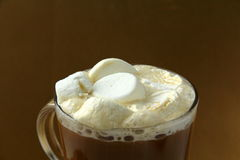 Coffee with marshmallows in large glass beaker Royalty Free Stock Images
