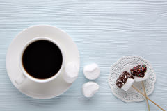 Coffee with marshmallows. Coffee with marshmallow on a light wooden background Stock Photos