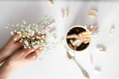 Coffee with marshmallows, and women`s hands the view from the top Royalty Free Stock Photos