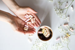 Coffee with marshmallows, and women`s hands the view from the top Stock Photos