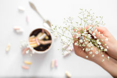 Coffee with marshmallows, and women`s hands the view from the top Royalty Free Stock Images