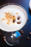 Coffee martini cup on a dark wooden table Royalty Free Stock Photos