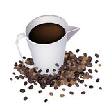 Coffee in Measure Cup with Coffee Beans Stock Image