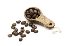 Coffee measuring spoon. On a with surface shot from angle, with a ligth shadow stock photo