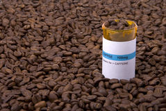 Coffee Medicine Bottle Surrounded by Beans Stock Photography