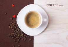 Coffee menu background.White cup and beans Royalty Free Stock Images