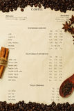 Coffee menu with roasted coffee beans and spices. Vertical coffee menu with roasted coffee beans, cinnamon, anise and spoon with clove on it royalty free stock photo