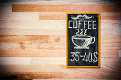 Coffee menu on wood wall Stock Photos