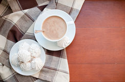 Coffee and meringues with a brown cloth Royalty Free Stock Photo