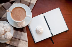Coffee, meringues, and a notepad Stock Image