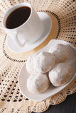 Coffee and Mexican wedding cookies close-up on a plate. vertical Stock Photo